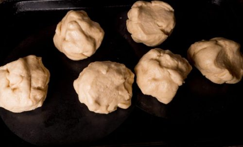 challah dough divided up into 6 pieces