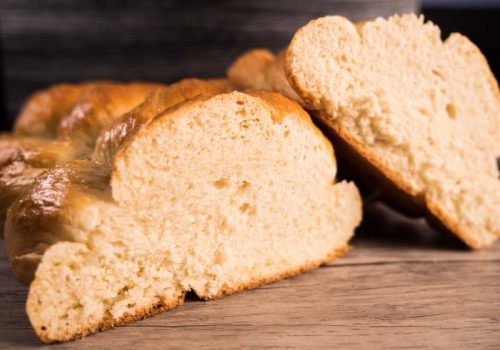 challah bread cut in half showing the texture of inside the bread