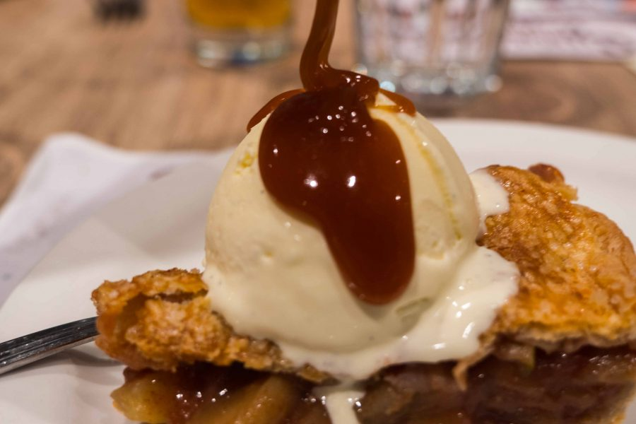 Apple pie with homemade ice cream and salted caramel sauce